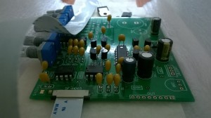 The new PCB half way through being soldered.